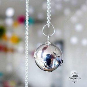 Silver ball pendant with stars